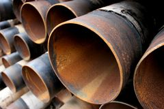 Large rusting steel pipes. Closeup of a pile of large and rusting steel pipes Stock Photos