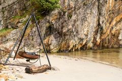 Large rusty fire pit or BBQ on beach in Norwegian fjord Stock Photography