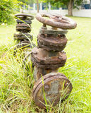 Large rusty old valve. To open and close the flow of water Stock Images