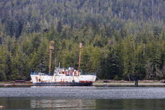 Large Rusty Ship on Shore of Alaska Stock Photography