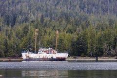 Large Rusty Ship on Shore of Alaska Stock Photography