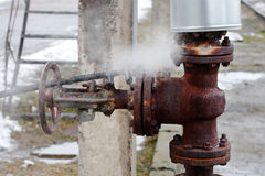 Large rusty valve is broken. Stock Image