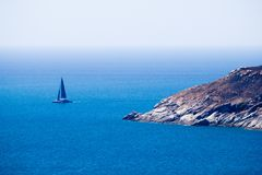 Lone sail boat out at sea Royalty Free Stock Image