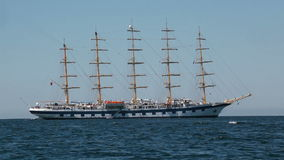 Large sailing ship with five masts anchored in the open sea. stock video