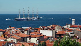Large sailing ship with five masts anchored in the open sea near old city Piran, Slovenia. stock video