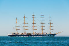 The large sailing ship with five masts anchored in the open sea Stock Image
