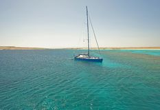 Large sailing yacht in a tropical lagoon Stock Images