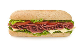 Large salami & cheese submarine sandwich. Fresh whole wheat salami sandwich with lettuce, cheese and tomatoes - frontal view Stock Image