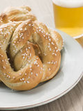 Large Salted Pretzel and a Glass of Beer Stock Images