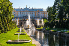 Large (Samson) Channel in Peterhof. Large (Samson) Channel with fountain mascarons with a view of Peterhof Grand Palace Royalty Free Stock Photos