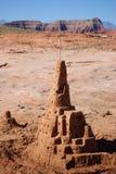 Large sand castle. Large sandcastle with southern utah landscape in background Stock Images