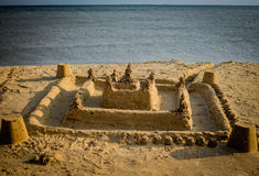 A large sand castle built by children's hands Royalty Free Stock Photography
