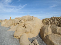 Large sand sculpture of a dinosaur Royalty Free Stock Photos
