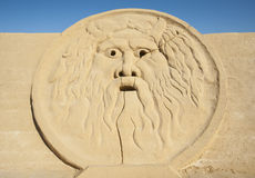 Large sand sculpture of La Bocca della Verita Stock Photos