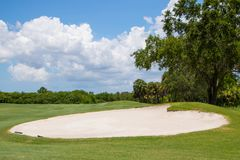 Sand Trap on Golf Course. Large sand trap on beautiful Florida golf course Royalty Free Stock Photos