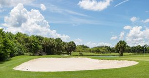 Sand Trap on Golf Course. Large sand trap on beautiful Florida golf course Royalty Free Stock Photography