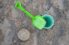Large sandbox on the beach. A large sandbox on the beach - a neat sand tower, next to it a toy bucket and a shovel Royalty Free Stock Images