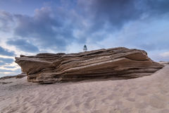 Large sandstone rock on the beach of Cape Trafalgar. Stock Photo
