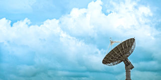 Large satellite dish with beautiful clouds royalty free stock photography