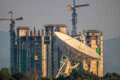 Large satellite dish on the building onstruction background. A Large satellite dish on the building onstruction background Stock Image