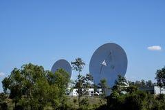 Large satellite dish radar antenna station with blue sky Royalty Free Stock Image