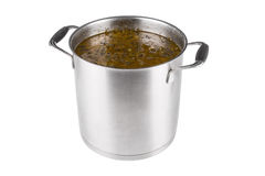Large saucepan with sorrel soup. On white background stock photo