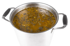 Large saucepan with sorrel soup. On white background stock photos