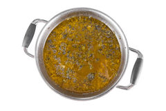 Large saucepan with sorrel soup. On white background royalty free stock photo