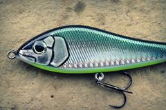 Large, heavy fishing glider lure plug. Large Savage Gear lure is primarily used for fishing for large species of fish such as muskie, big bass or pike royalty free stock images