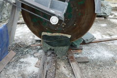 A large saw used to cut jade mined in canada. Stock Photos