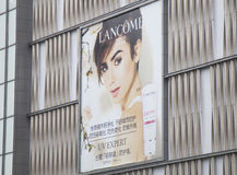 Large scale advertising board of Lancome cosmetics and skin care outside a building. Shenzhen, China - Jun 13, 2016: Large scale advertising board of Lancome Stock Photo