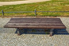 Large-scale brown wooden park bench stock images