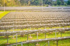 Large scale solar farm, mega photovoltaic power plant in green g. Rass field Royalty Free Stock Image