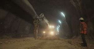 Large scale tunnel construction project stock footage