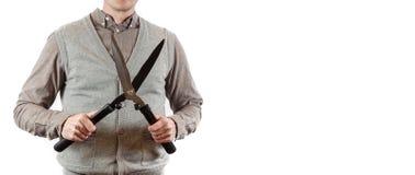 Large scissor. A gardener holding a hedgecutter. stock image