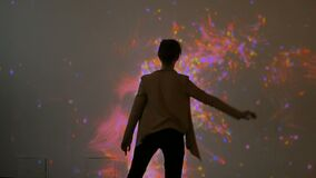 Large screen augmented reality experience. Woman waving her arms in front of display. Science, future and technology concept stock video footage