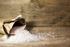 Large sea salt. On wooden background Royalty Free Stock Photography