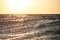 Large sea waves at sunset closeup Royalty Free Stock Image