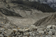 Large section from Khumbu glacier with layers made by ice, rocks, mud, small vegetation. Nepal. Royalty Free Stock Image