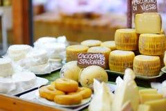 Large selection of cheeses on italian farmer market Stock Photos