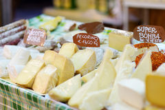 Large selection of cheeses on italian farmer market Stock Photos