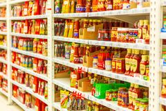 A large selection of ketchup and seasonings and sauce in a large supermarket. Russia, Samara, January 2019: a large selection of ketchup and seasonings and sauce stock images