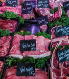 A large selection of meats, cold cuts and sausages with prices, Royalty Free Stock Photography