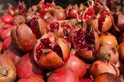 Pomegranates, India. A large selection of ripe pomegranates, latin name punica granatum, on display at a market stall, Hyderabad, India Stock Photo