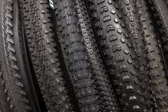 Large selection of tires with a different tread. Modern mountain bike tire. Element of bicycle. Large selection of tires with a different tread stock images