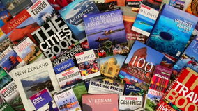 Large Selection of Travel Guides and Books Royalty Free Stock Photos