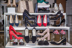 Large selection of women's shoes on the shelf in the store Royalty Free Stock Images