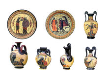 A large set of ancient Greek vases and plates on a white backgro Stock Photo
