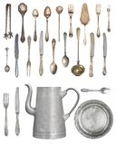 A large set of antiques isolated on a white background. Old spoon, fork, knife, kettle, steamer royalty free stock image