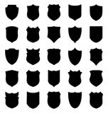 Large set of black shields silhouettes Stock Images